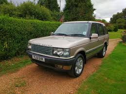 gold range rover 2001 range rover vogue being auctioned at barons auctions