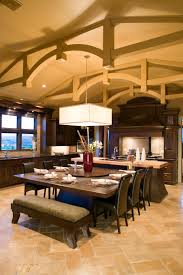 uber luxurious custom contemporary kitchen designs this stately kitchen stands dark wood furniture over light orange tile flooring with large dining