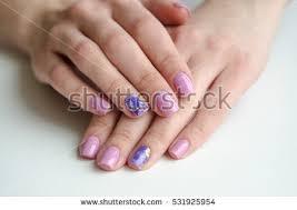 closeup shot beautiful female hands pink stock photo 531925954