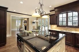 black granite top kitchen island granite kitchen islands kitchen with brown cabinets and light