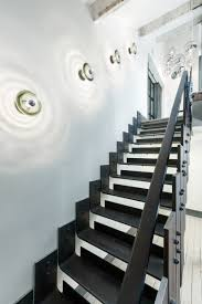 pressed glass wall lights by tom dixon light the stairway of the