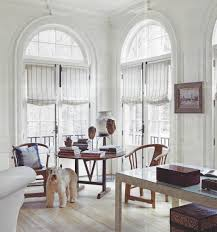 arched window over french doors with casual roman shades home