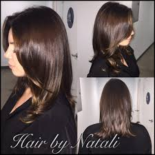 lon haircut with natural brown color and subtle balayage