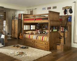 brown wooden bunk bed with brown wooden stair also drawer and