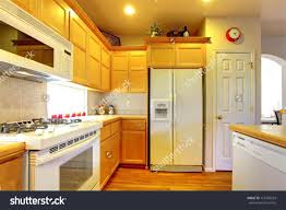 White Kitchen Cabinets White Appliances by Light Wood Kitchen Cabinets With White Appliances Sets Design Ideas
