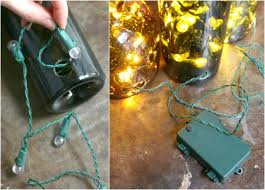 wine bottle string lights how to put christmas lights in a wine bottle ehow