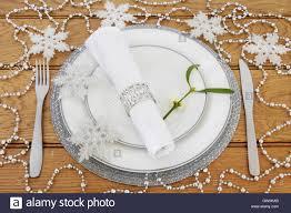christmas dinner table setting with white plates cutlery linen christmas dinner table setting with white plates cutlery linen serviette with ring mistletoe