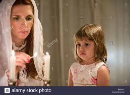 mother and daughter lighting shabbat candles stock photo royalty