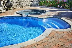 outdoor inground residential swimming pool in backyard with