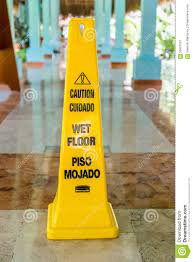 Slippery Floor Wet Floor And Caution Warning Sign In Spanish And English Stock