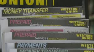 western union agrees to pay victims of scam 586m cbs