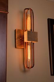 rebar and barn wood sconce vanity light fixture in rubbed red