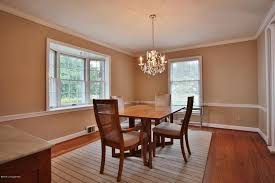 traditional dining room with chair rail u0026 hardwood floors in