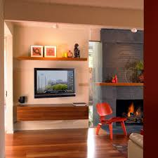 fireplace next to tv living room eclectic with red side chair wall