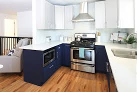 navy blue kitchen cabinets navy is the new black all the perks of navy cabinets
