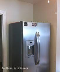 gap between fridge and cabinets the gap between the refrigerator and the cabinets is filled with a