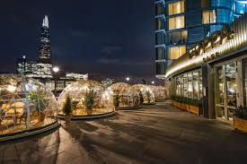 giant igloos have sprung up near tower bridge london evening