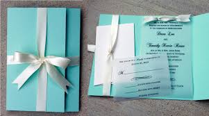 robins egg blue wedding invitation blue with white ribbon