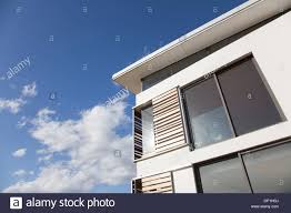 Modernhouse by Low Angle View Of Wood Shutters On Modern House Stock Photo
