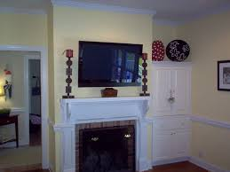 shelving ideas beside stone fireplace with tv above google