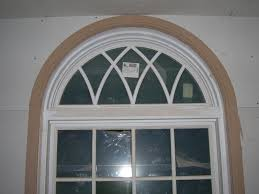 love this wrought iron for the half moon windows in the secondary