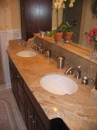sand granite countertop with rounded undermount sink combined with