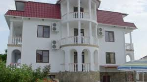 three story house with white balustrade balcony swimming pool and