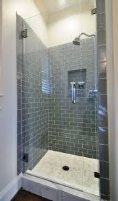 best 25 small master bathroom ideas ideas on pinterest small guest bath simple grey glass subway tile shower with white grout white vanity light grey walls dark grey mirror chrome fixtures