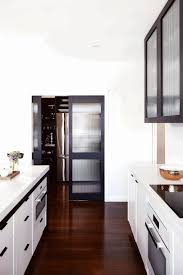 kitchen designs with walk in pantry walk in pantries simple wooden flooring dark brown wooden