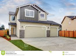 simple northwest town house with nice garage stock photo image