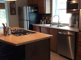 should i paint or stain my oak kitchen cabinets would like advice to update my oak cabinets painting or