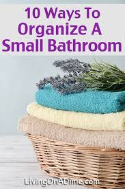 Ways To Decorate A Small Bathroom - how to organize a small bathroom living on a dime