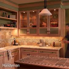 under cabinet lighting for kitchen how to install under cabinet lighting in your kitchen family handyman