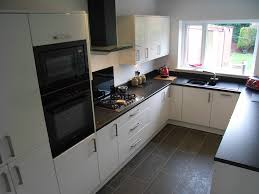 kitchen with black appliances cherry cabinets with black