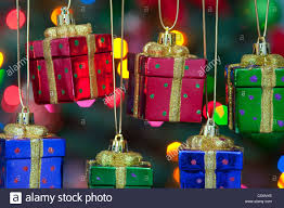 present ornaments hanging from a tree with