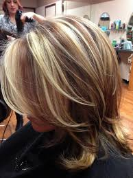 short blonde with brown underneath blonde highlight