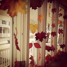fall bay window decorating idea fabric leaves tied onto clear
