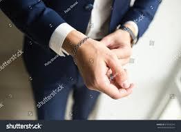 man hand bracelet images Mens hand suit silver bracelet on stock photo edit now 573729310 jpg