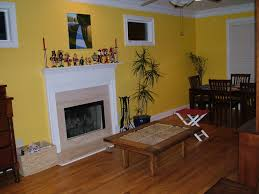 yellow red living room accent wall carameloffers