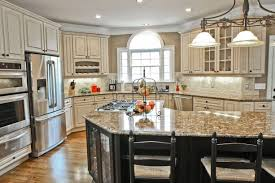 kitchen with black island and white cabinets 17 best antique white cabinets combinations for most