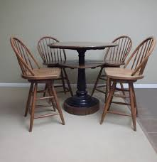 Oak Table With Windsor Back Chairs Antique Cast Iron Oak Tavern Table And Swivel Chairs Ebth