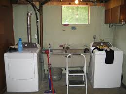 before makeover basement laundry room design with mounted sinks