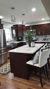 travertine countertops dark brown cabinets kitchen lighting