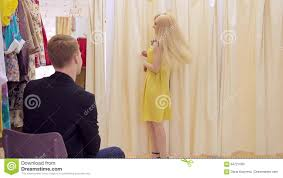attractive with smile shows yellow dress to the guy in