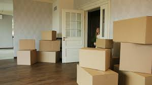 Moving To A New Property by Unpacking Boxes In New Home On Moving Day Moving To A New Home