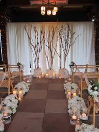 wedding backdrop tree i don t like bottom i do like the large sticks or trees with