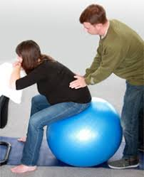Sitting On A Medicine Ball At Desk Using A Birthing Ball Babycentre Uk