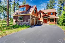 big luxury house with brown and orange siding trim view of