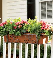 hanging shutters on the balcony railing planter