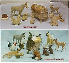 carved painted wooden animals